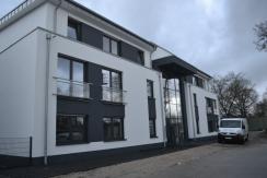 Große Erdgeschosswohnung – KfW 55 – Erstbezug- Garten-Tiefgaragenplätze